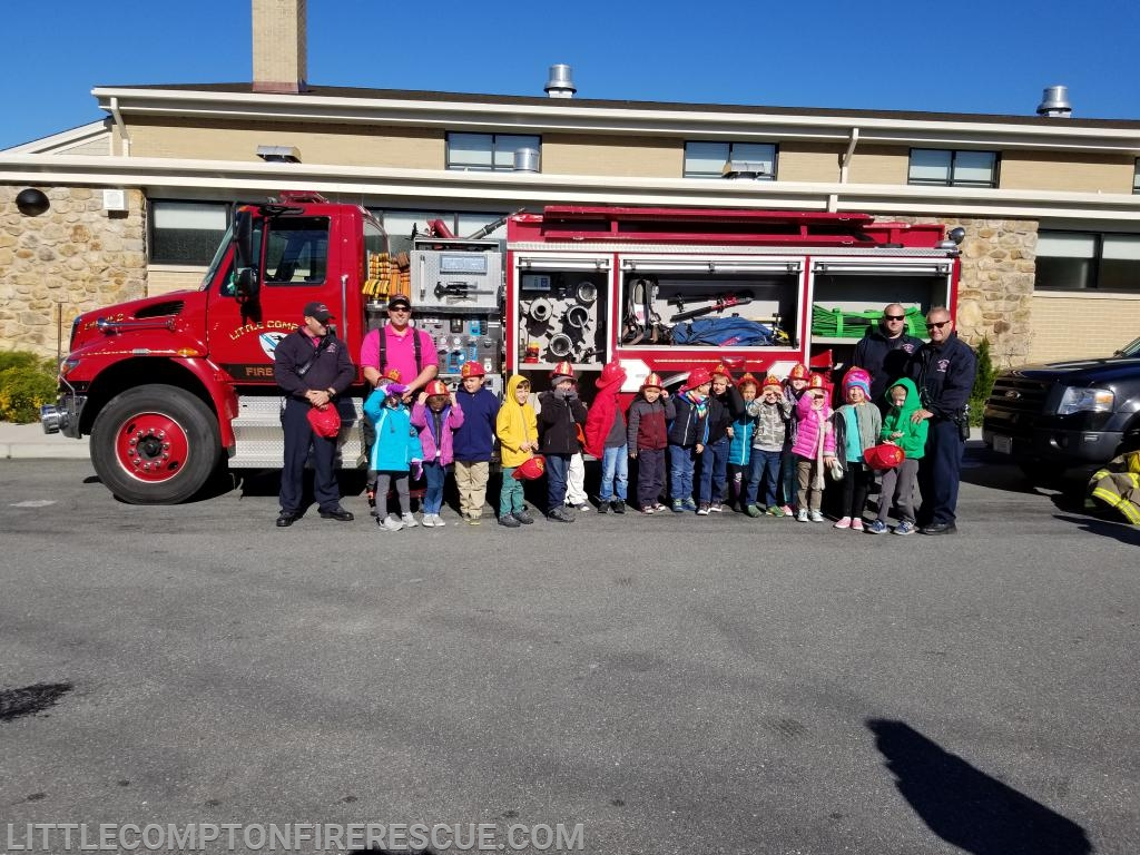 FF Condon, FF Cabral, FF Hussey, and Capt. Watt with some of the kids in front of Engine 2.